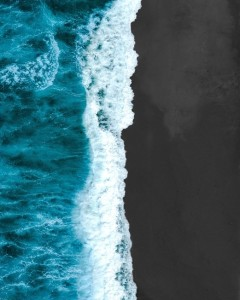 waves crashing on a beach viewed from above
