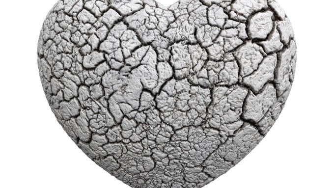 A heart-shaped stone with surface crackled like a molasses cookie.