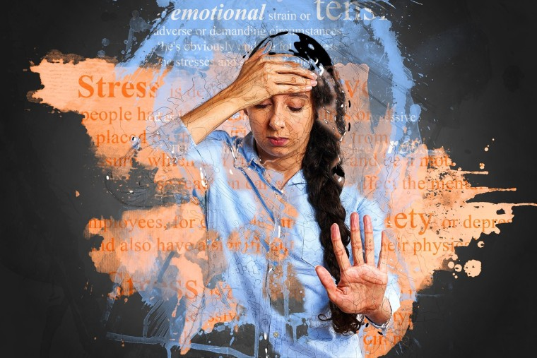 A woman with closed eyes holds one hand on her forehead while the other hand pushes away in front of her. She is surrounded by words associated with stress and anxiety.